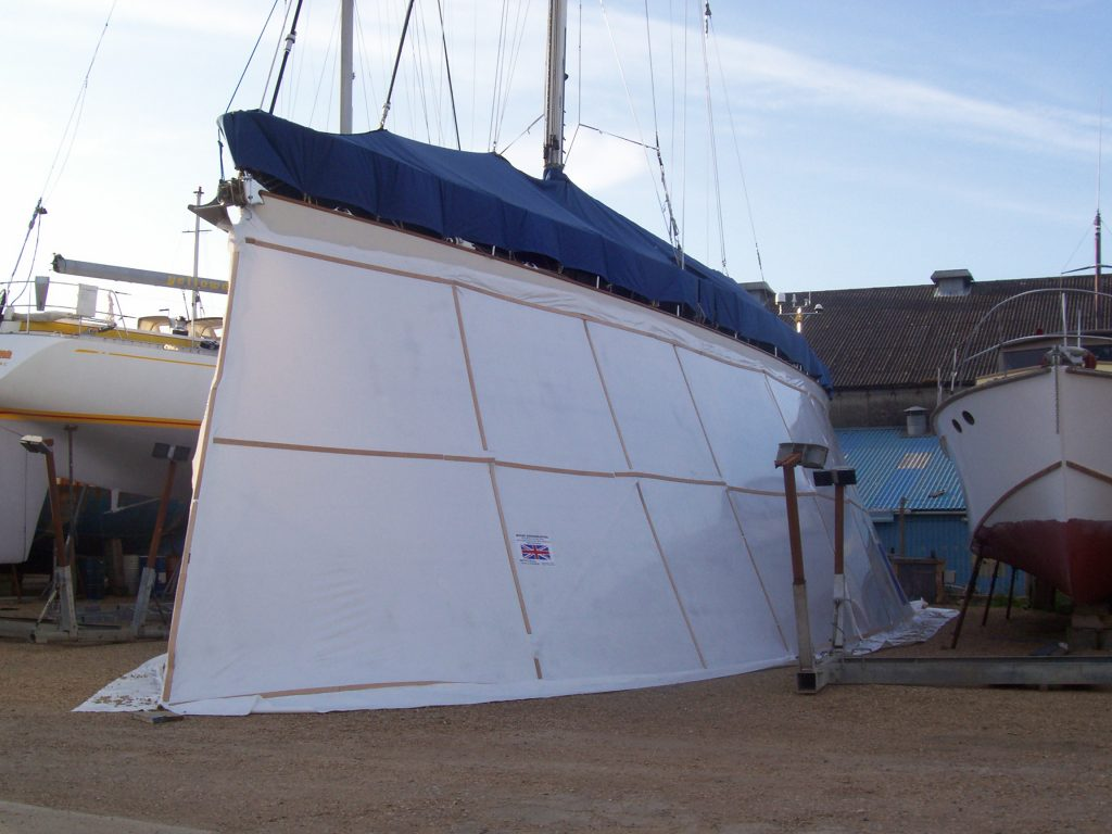 Yacht after hull has been shrink wrapped around wooden frame