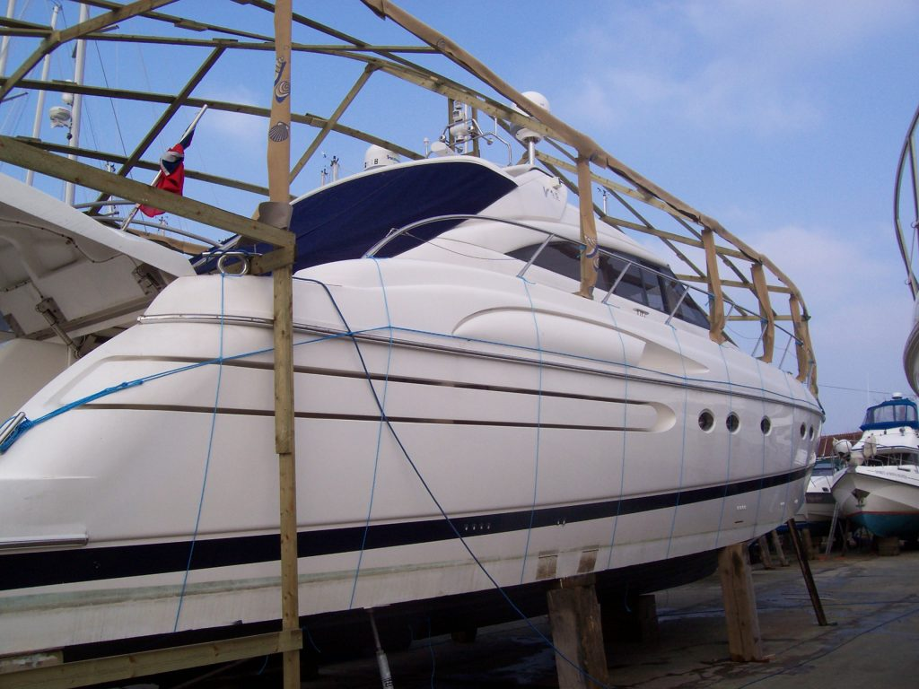 Motor Yacht with frame over decking ready to be shrink wrapped